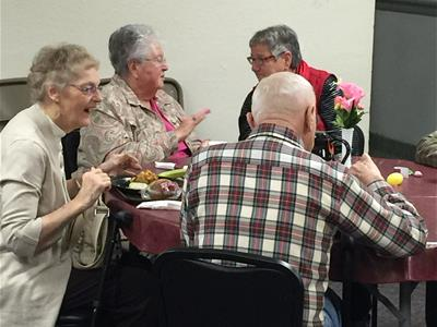 Photo of Seniors enjoying lunch at the Senior Center